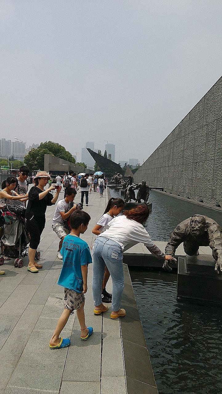 Tourists outside the Nanjing Massacre Memorial Hall in China. Continued denial by right-wing Japanese politicians of the undeniable - that Japanese troops committed atrocities in Korea and China, including the Nanjing Massacre - is an obstacle to bet