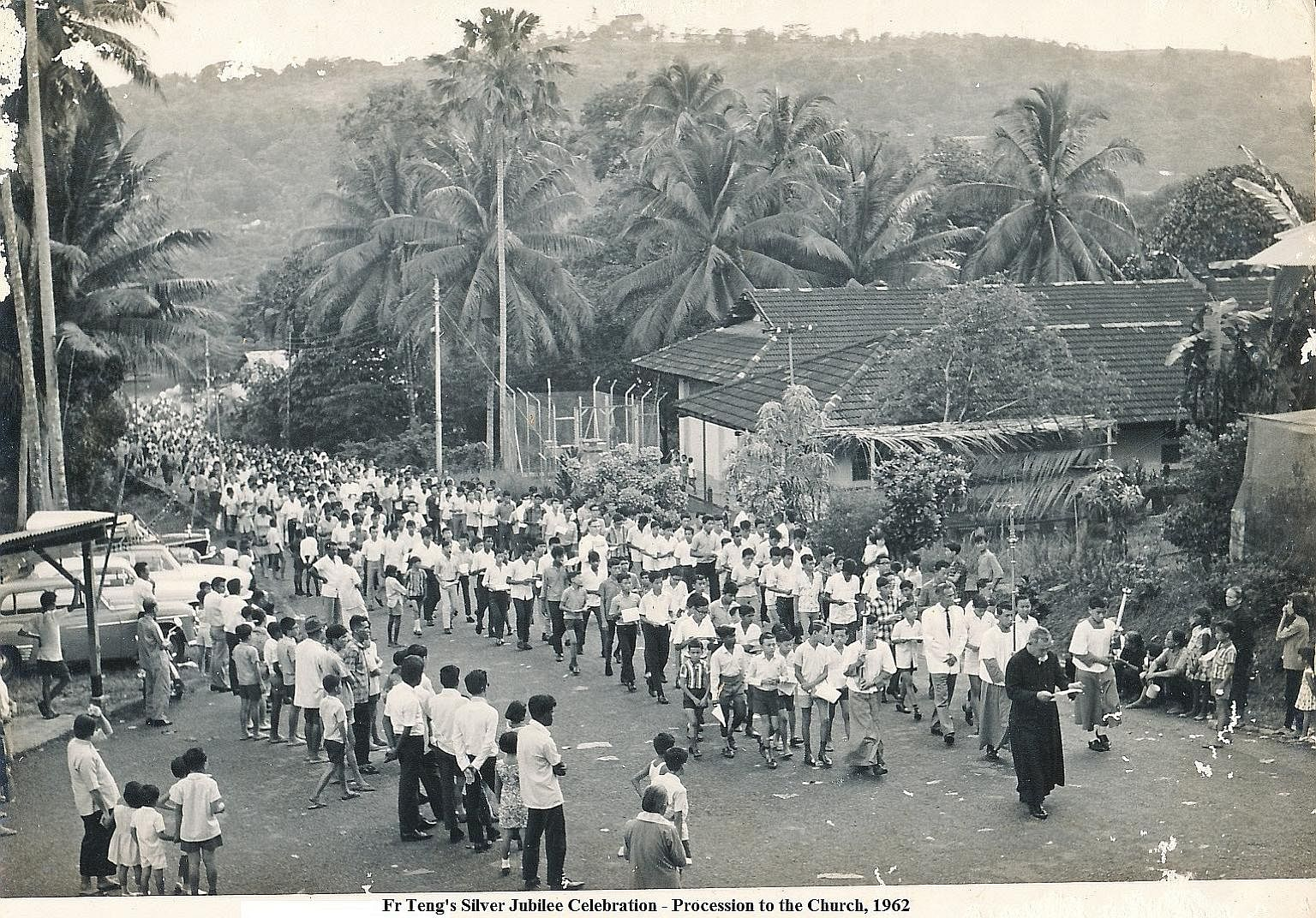 Father Teng leading parishioners in a procession to the church in 1962 to celebrate his Silver Jubilee.