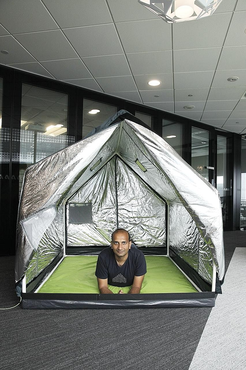 billionBricks co-founder Prasoon Kumar with the weatherHyde tent. In winter, the triple-layer cover provides insulation while reflective material on the inside traps body heat. In summer, the tent cover can be reversed to reflect solar heat so that p