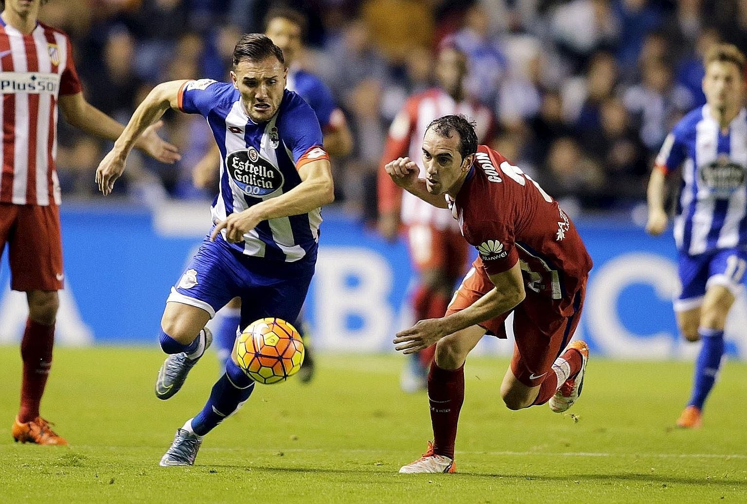 Deportivo Coruna's Lucas Perez (left) fighting for possession against Atletico Madrid's Diego Godin last year. EPL clubs do not always attract the very best Spanish players.