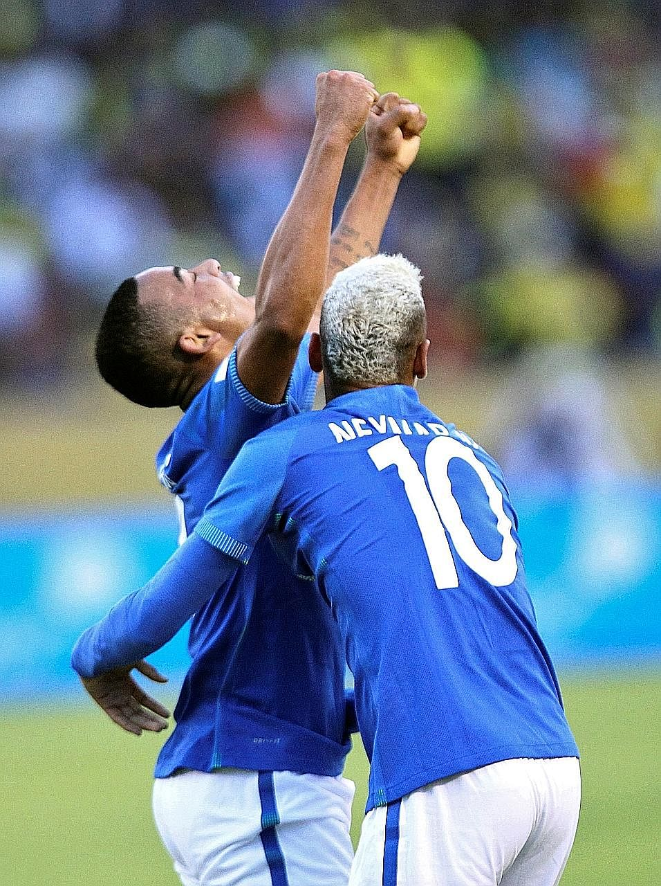 Forward Gabriel Jesus (left) celebrates with Neymar after scoring his first senior goal for Brazil. He scored again in stoppage time.