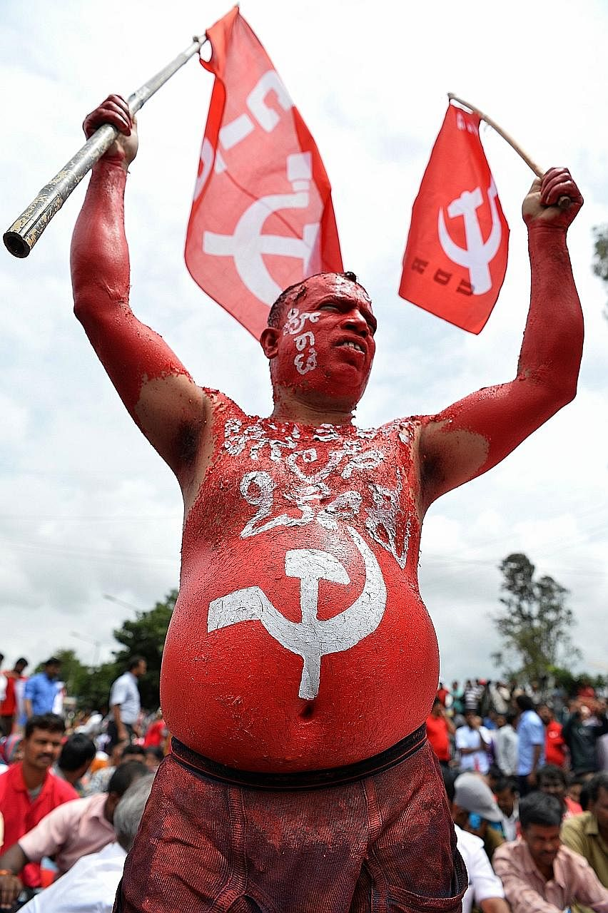 A Centre of Indian Trade Unions activist during a protest in Bangalore yesterday as part of nationwide stoppages.