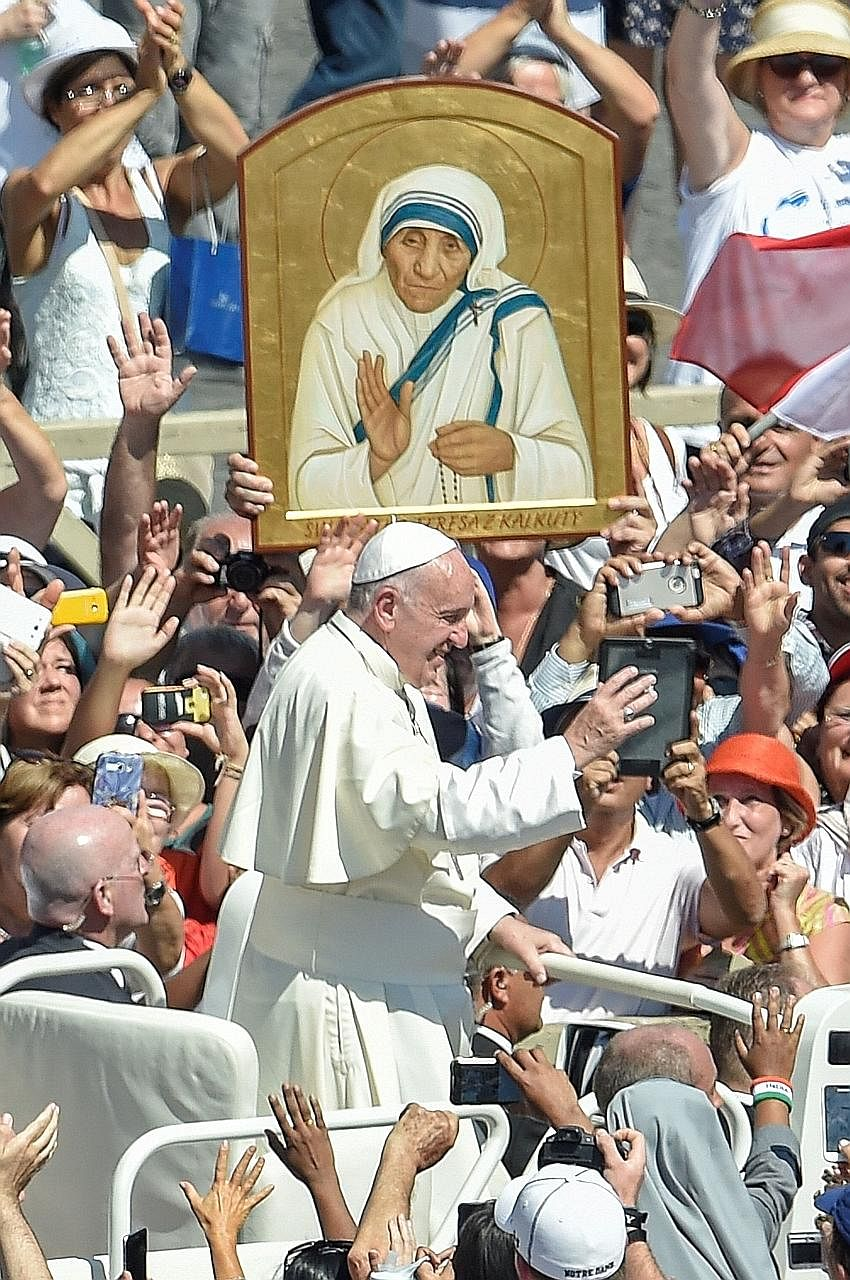 Pope Francis with pilgrims at the Vatican yesterday. The Nobel peace laureate was canonised yesterday, just 19 years after her death.