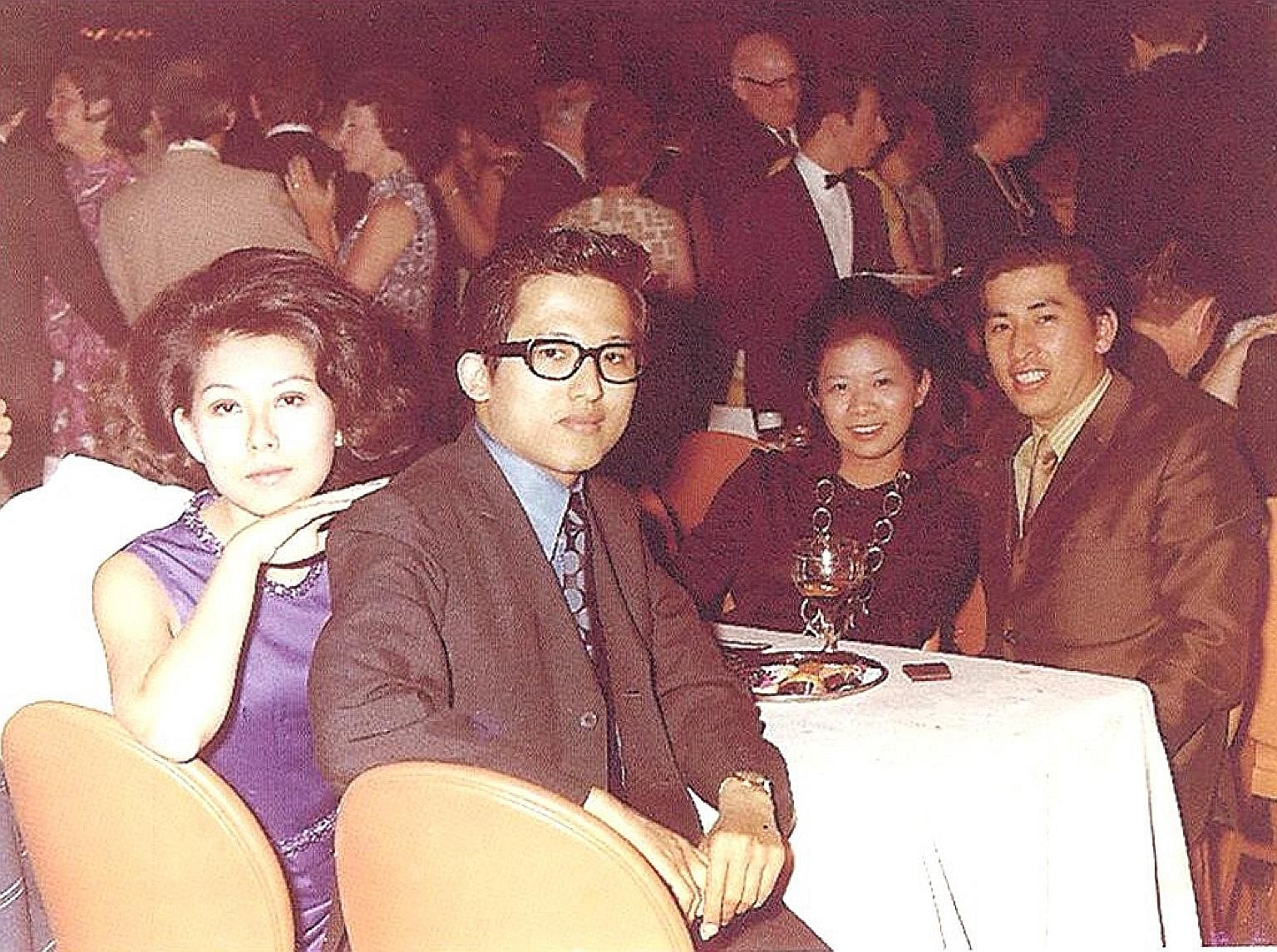 Mr Kwek Leng Beng with his wife, Cecilia Kok (both above), in London in 1970; and at the opening of Hong Leong Finance Lavender Street branch in 1967.