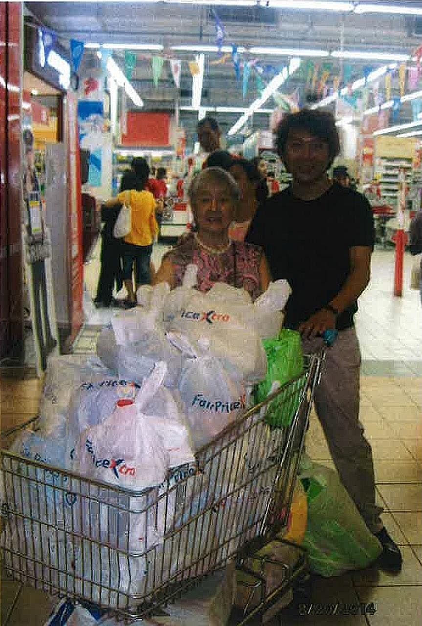 Among the photographs submitted by Yang's lawyer to make the point that the former tour guide took care of Madam Chung and took her to places where she wanted to go, is one of the two of them with a trolley of groceries at a supermarket.