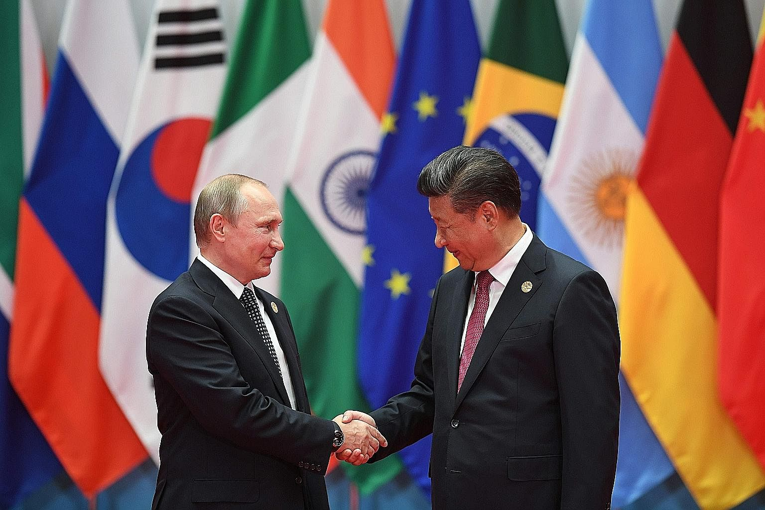 Russian President Vladimir Putin meeting Chinese President Xi Jinping at the G-20 summit in Hangzhou earlier this month. As more unites Beijing and Moscow than divides them, both have agreed to tactically cooperate on a range of issues that touch on