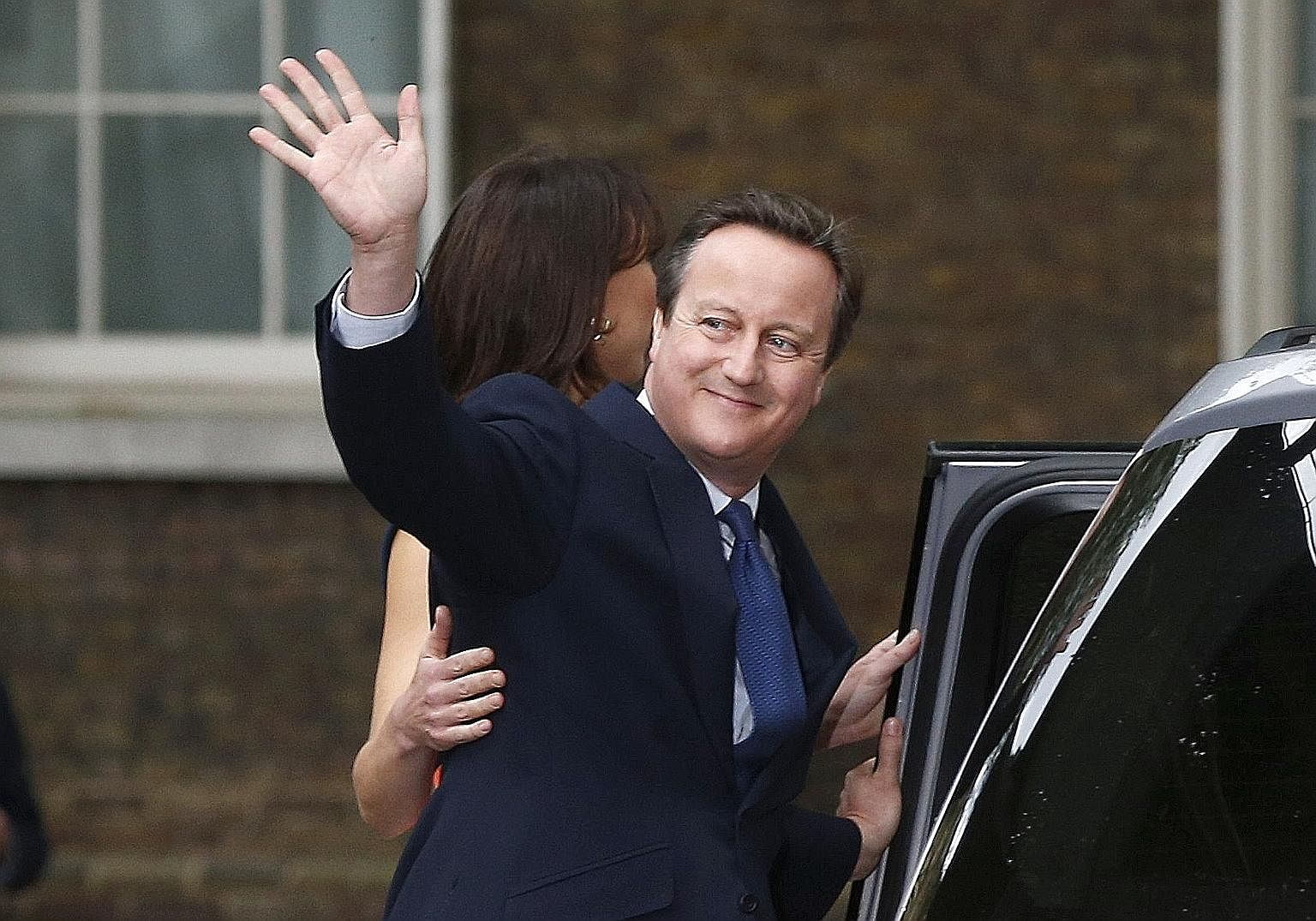 Mr David Cameron and his wife Samantha in front of No. 10 Downing Street on July 13, his last day in office as prime minister. He resigned as PM shortly after his defeat in the June 23 referendum in which Britain voted to leave the European Union.