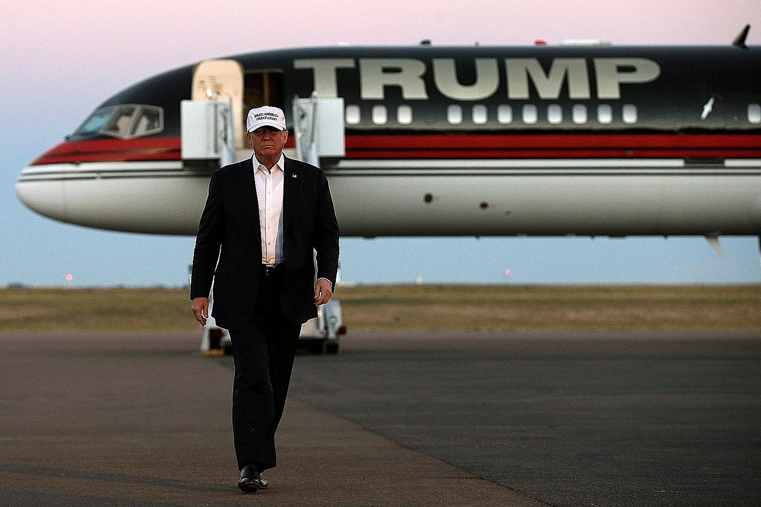 Mr Trump arriving in Colorado for a campaign rally on Saturday. Routine falsehoods, unfounded claims and inflammatory language have long been staples of his anything-goes campaign.