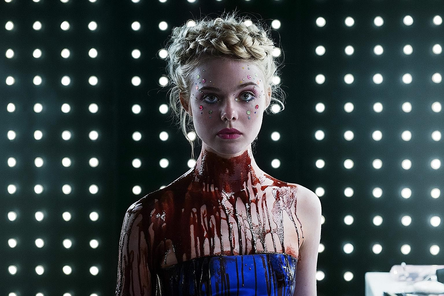 Elle Fanning (left) plays a model with otherworldly beauty in The Neon Demon.