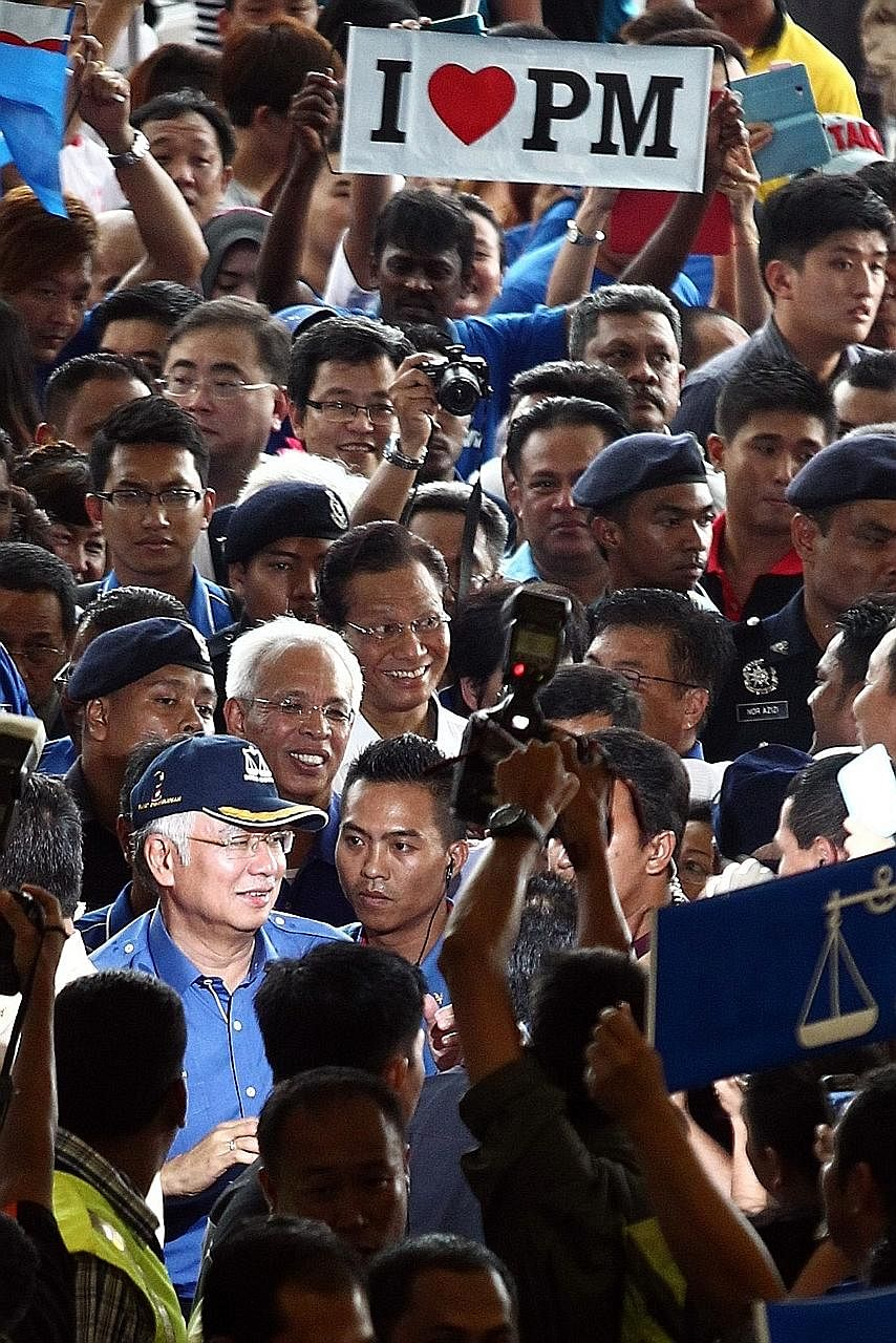 Malaysian Prime Minister Najib Razak (wearing a cap) at a rally for the 2013 general election. Although Mr Najib does not have to call for a national election until mid-2018, the signs point to an election in 2017, possibly in the later half.