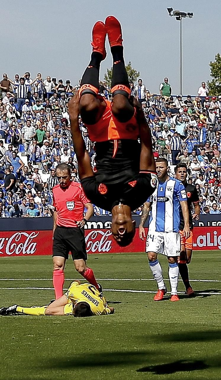 Winger Luis Nani celebrating his first Valencia goal, having curled the ball into the bottom corner after 34 minutes to cancel out Alexander Szymanowski's opener in the Spanish football club's 2-1 win over Leganes yesterday. Valencia, owned by Singap
