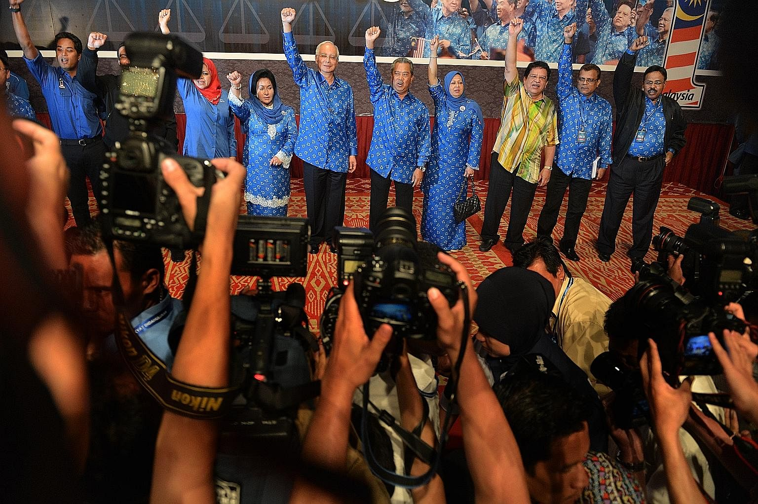 Mr Najib (centre) and his fellow BN members celebrating their election victory on May 6, 2013. The next general election is not due until August 2018, but rumours of early elections persist.