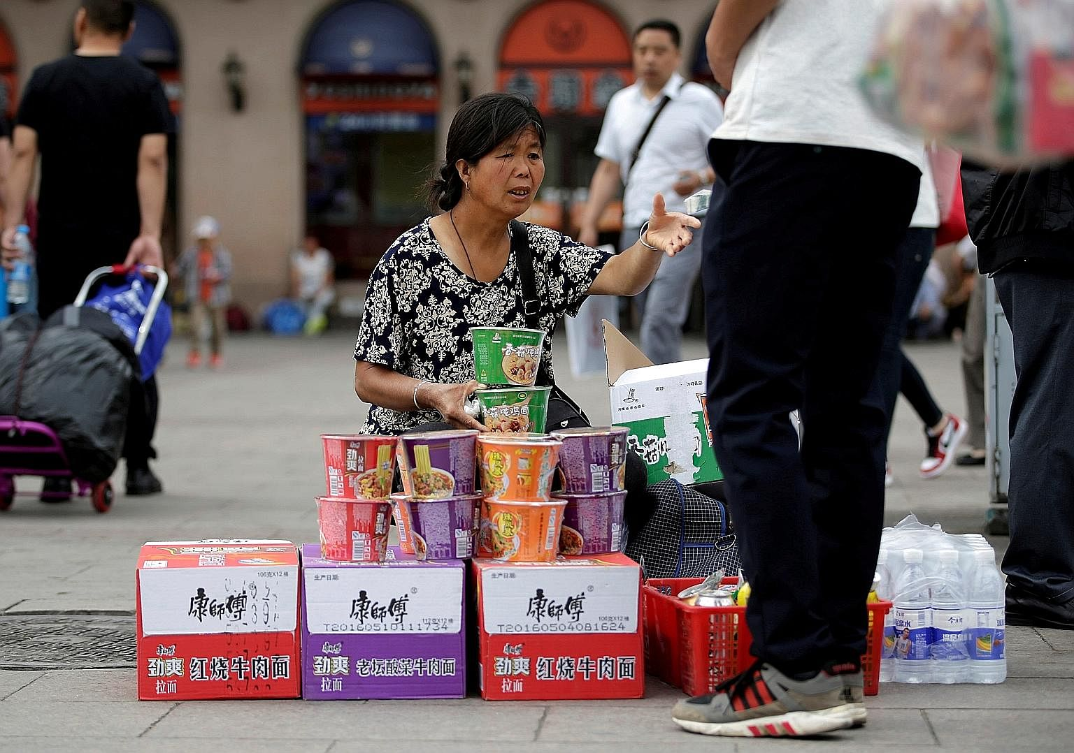 Instant noodles being sold at Beijing Railway Station in China. Just as China's economy has slowed, so too has its appetite for instant noodles.
