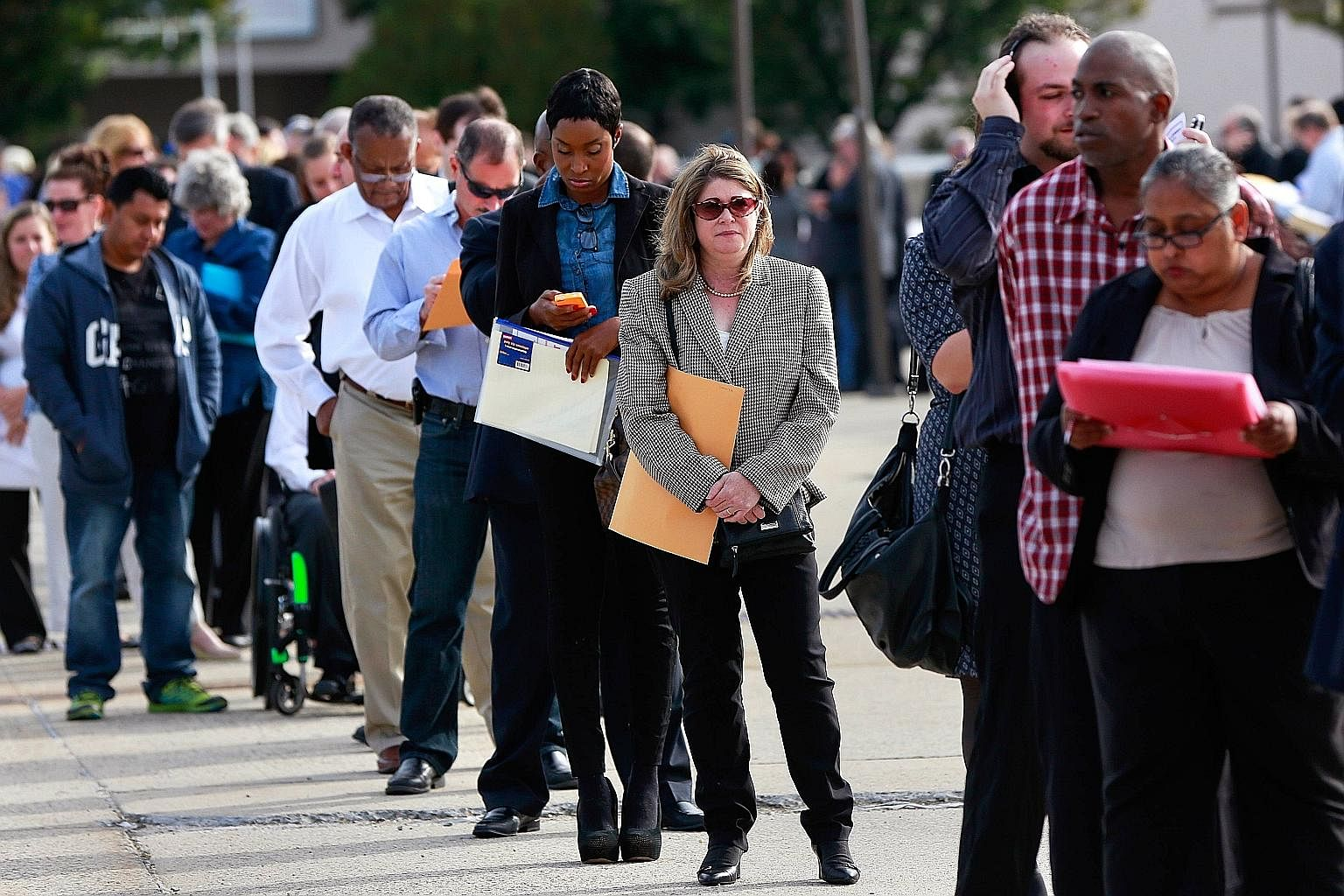 People waiting in line to enter a job fair in New York.Americans have been moving away from a system in which a good job with a generous employer was the key to a good life, to a new system in which even people with low-wage jobs can have access to t