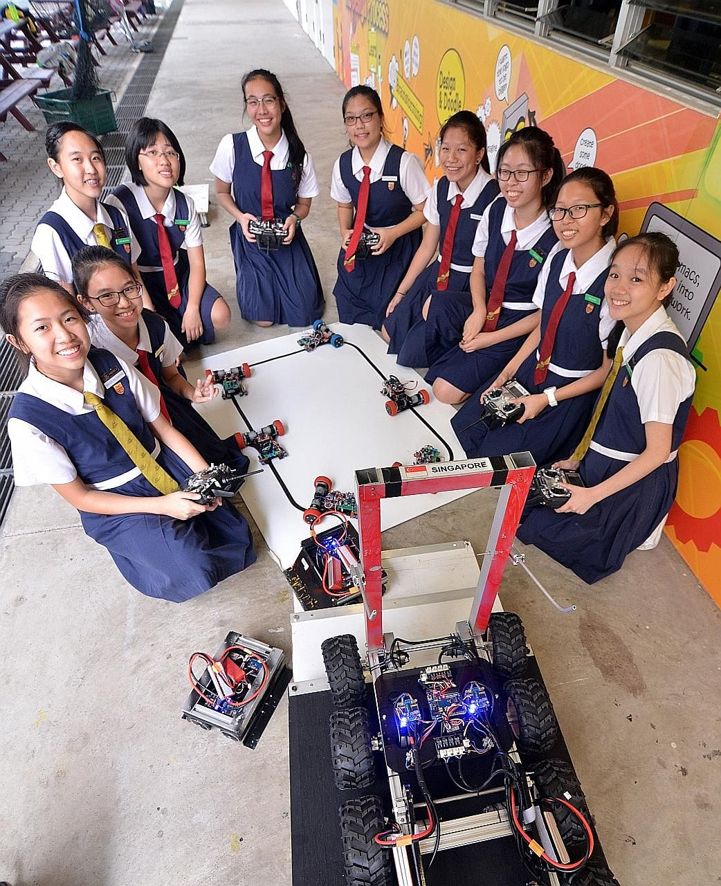 The team from Paya Lebar Methodist Girls' School (Secondary) that represented Singapore in the World Robot Games International competition in Indonesia comprised (from left) Charissa Wee Sze Hui, 13; Angel Yip Enqi, 13; Joan Lim Shuxian, 15; Woo Jie