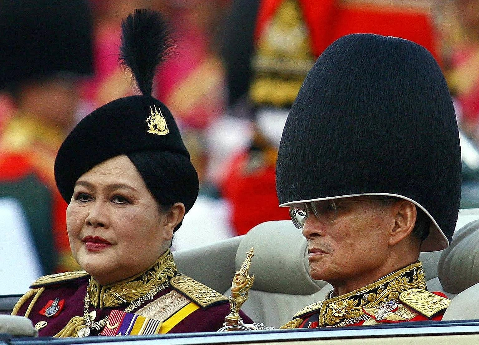 King Bhumibol Adulyadej and Queen Sirikit at celebrations in Bangkok to mark his 79th birthday in 2006. For the majority of Thais who have known only one monarch amid decades of political turbulence, the King's death represents the loss of a moral au