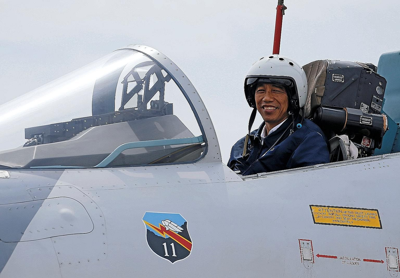 Mr Joko in the cockpit of a fighter jet while attending a military exercise on Oct 6. He has shown that he can rise to the occasion in tough situations.