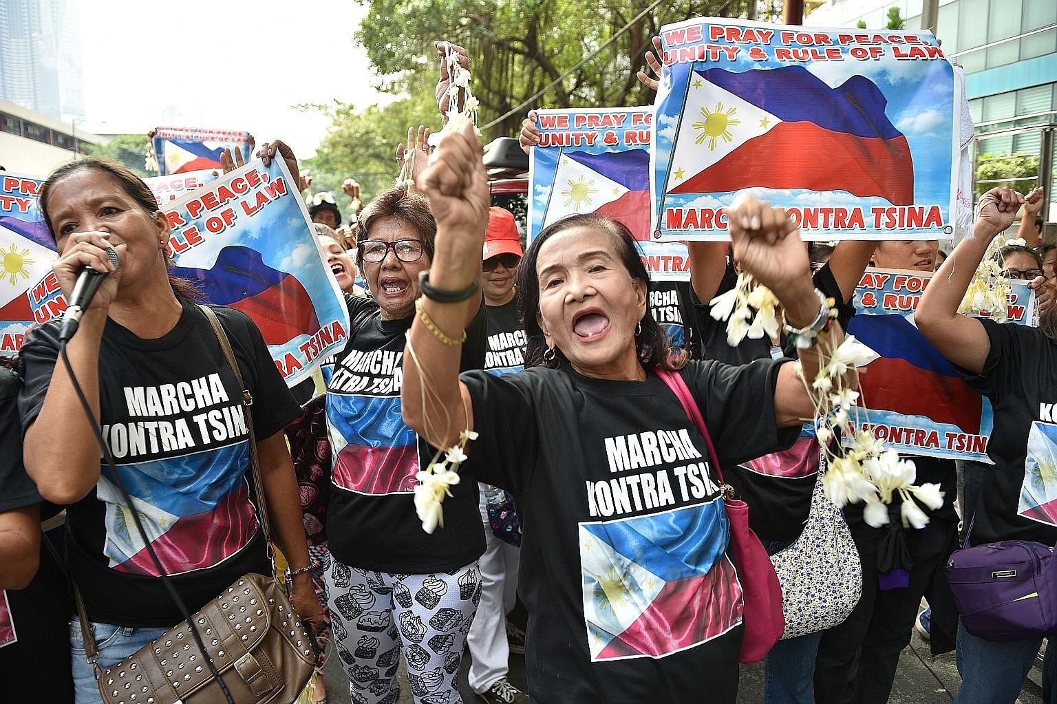 Filipino protesters calling on China to respect their rights in the South China Sea in front of the Chinese consular office in Manila in August. China sees its relations with Asean as a zero-sum game because the SCS and the region has become its non-