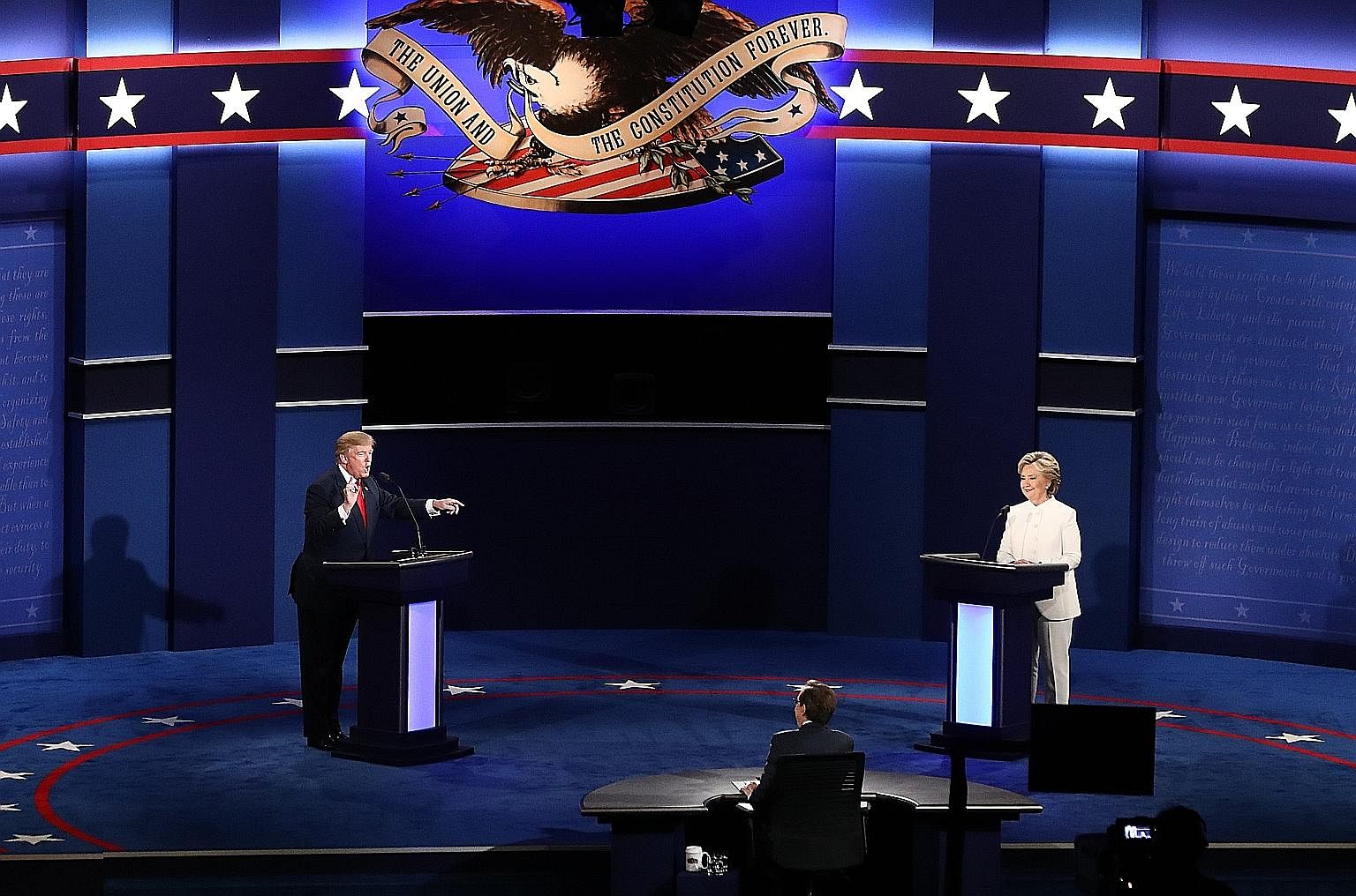 Mr Trump and Mrs Clinton at the third presidential debate in Las Vegas last week. The binary character of US politics is an anachronism in a world where nearly all democracies are now multi-party systems, says an academic.