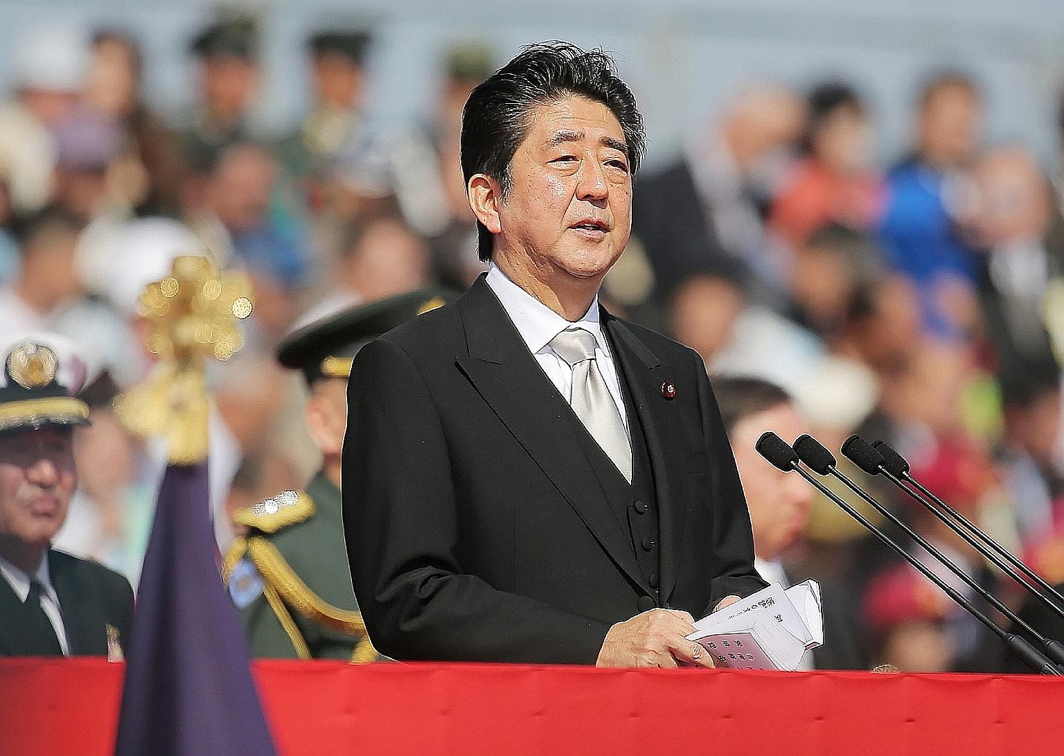 Mr Abe was due to step down as LDP president in September 2018 if not for the rule change - which must be formally approved at a party convention next March.