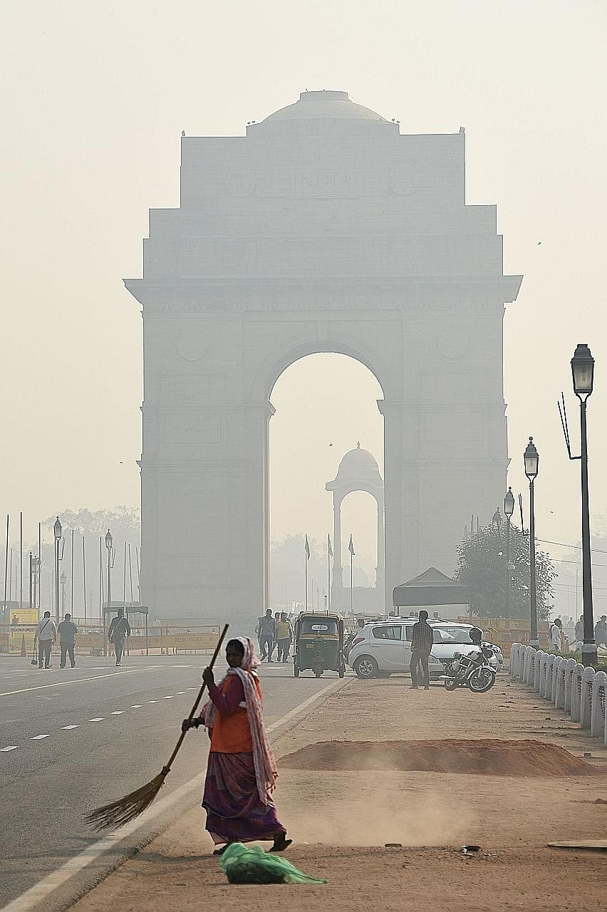 The India Gate monument on Friday. Residents in Delhi had to bear with days of smoke as the city celebrated Diwali - also known as Deepavali - with fireworks.