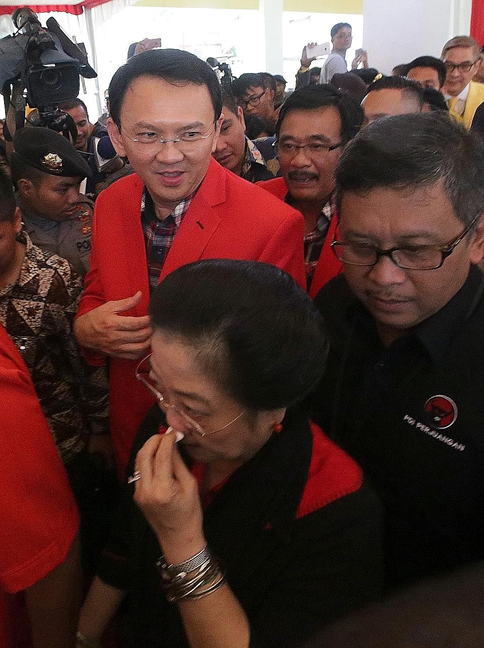 Governor Basuki Tjahaja Purnama (centre) with former president Megawati Sukarnoputri and his deputy Djarot Saiful Hidayat (behind him). Thousands of Muslim hardliners are expected to arrive from outside the city on Friday to join Muslims in Jakarta i