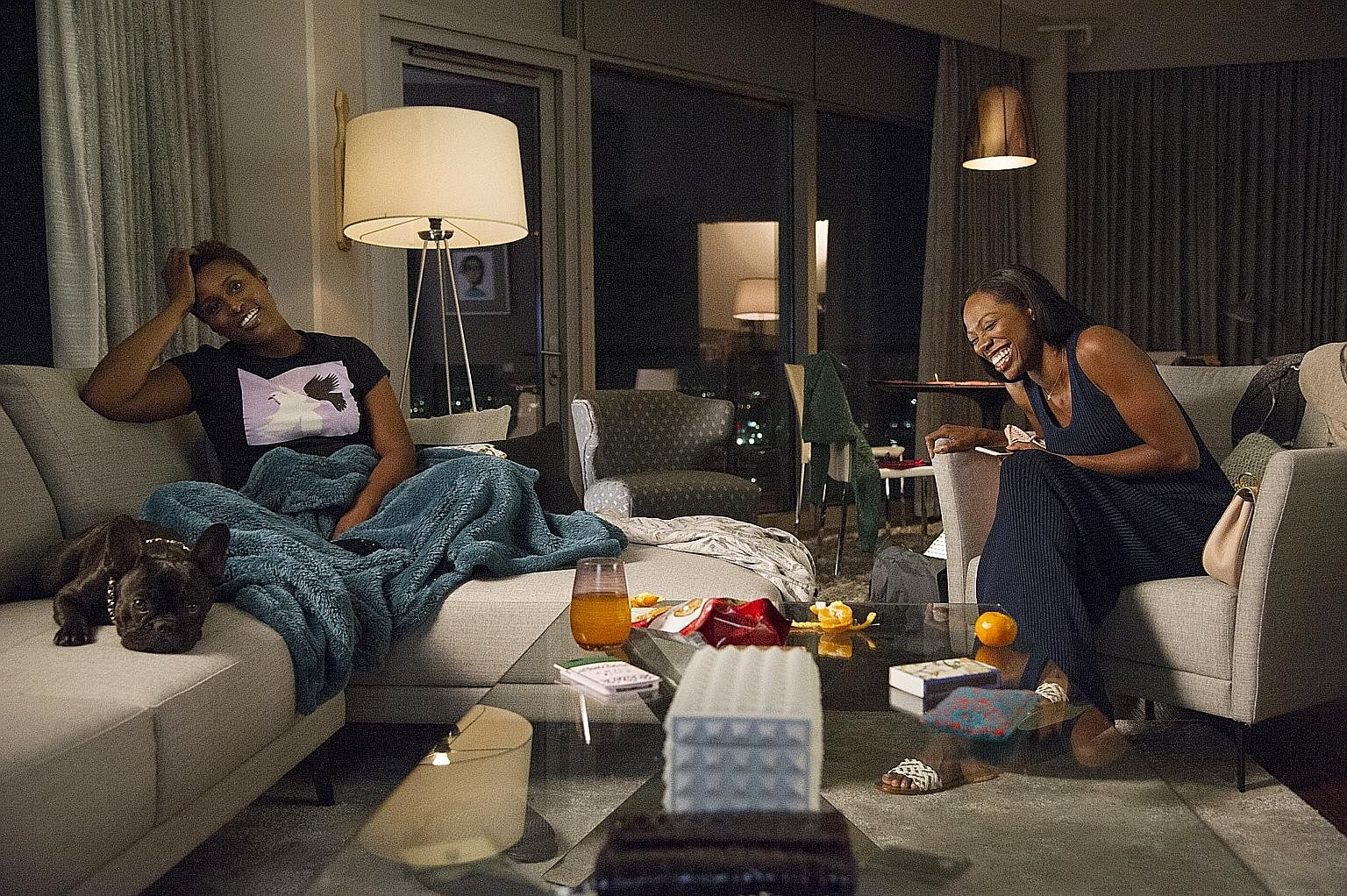 Yvonne Orji (far left) and Issa Rae in Insecure.