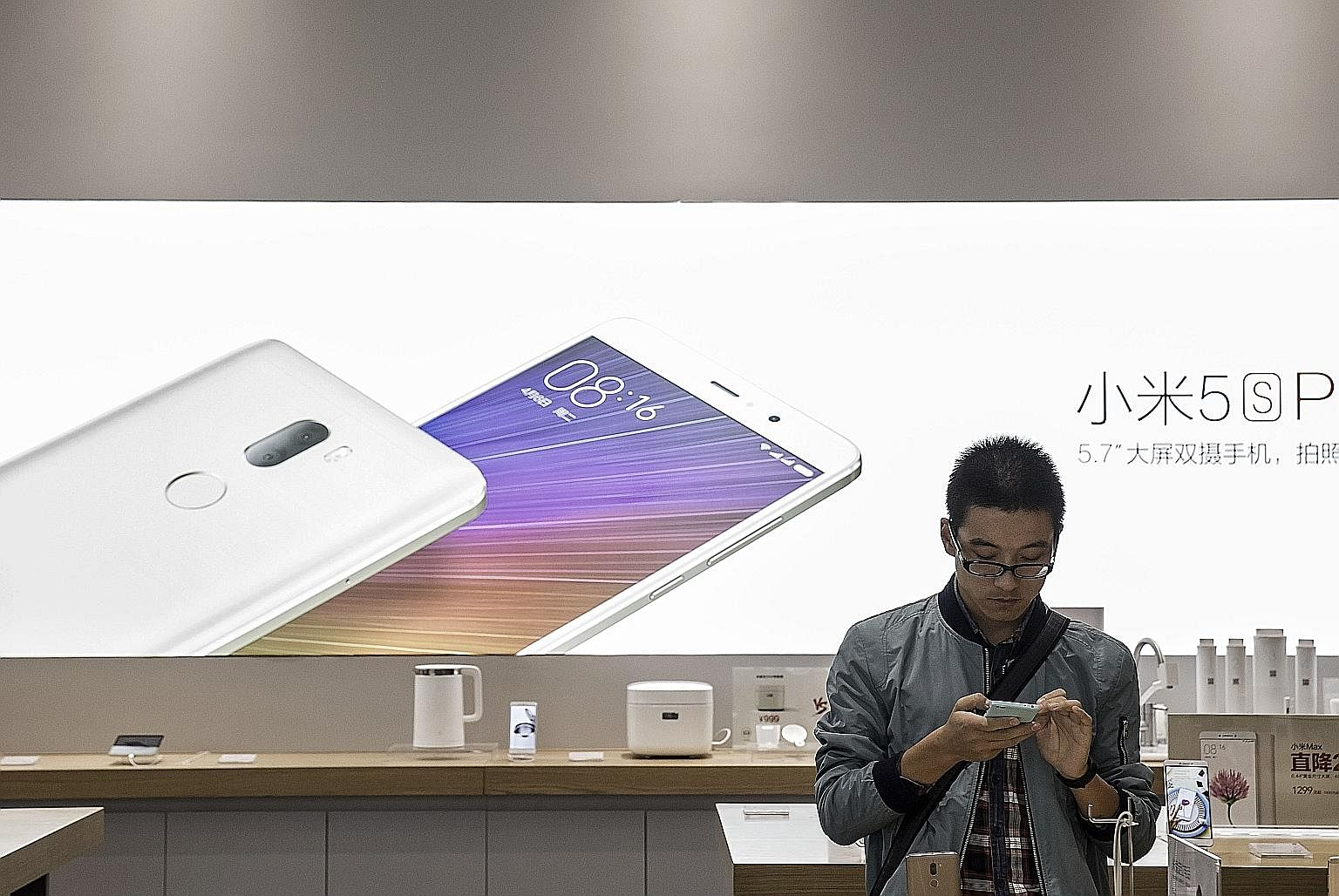 A customer checking out a Xiaomi smartphone in a Beijing store. How Xiaomi's gamble with the Mi Mix pans out will become evident over the next few months.