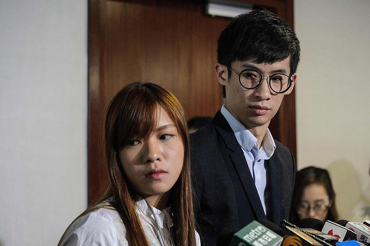 Pro-independence lawmakers Yau Wai Ching (left) and Baggio Leung.