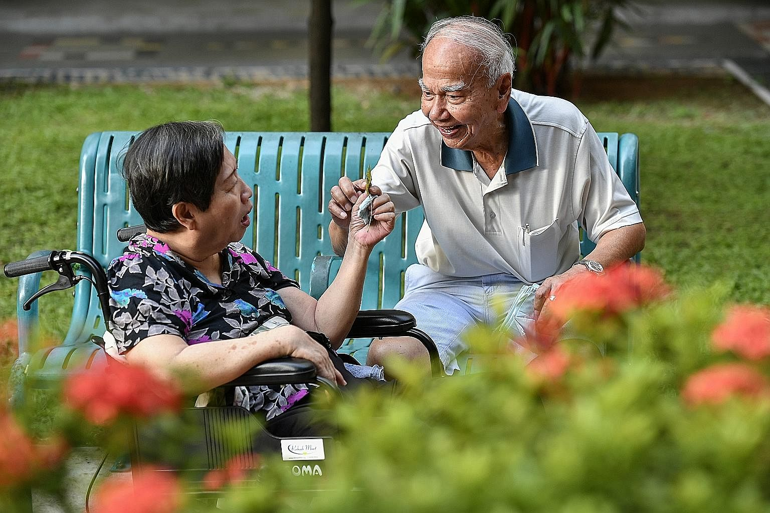 Mr Wong takes Madam Pang out in her wheelchair every morning. An active member of the Colon Cancer Patient Support Group, he also mans a hotline and counsels newly diagnosed colon cancer patients.