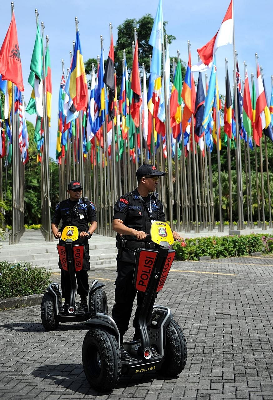 Indonesia police on patrol in Nusa Dua, on the resort island of Bali, where the 85th International Police (Interpol) General Assembly was held yesterday.