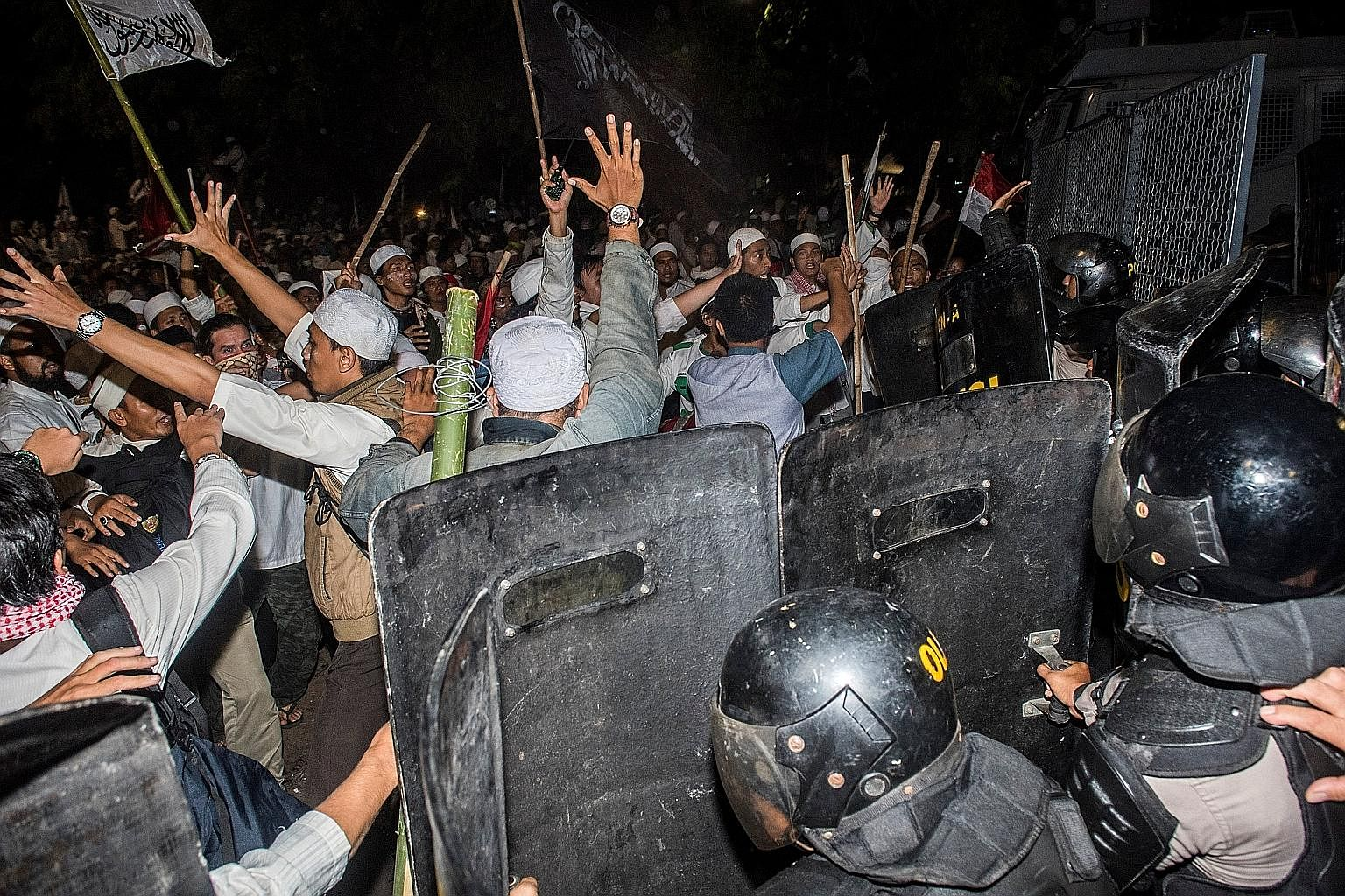 Muslim hardliners clashing with anti-riot policemen during a protest against Jakarta's ethnic Chinese Christian governor, Mr Basuki, last Friday.
