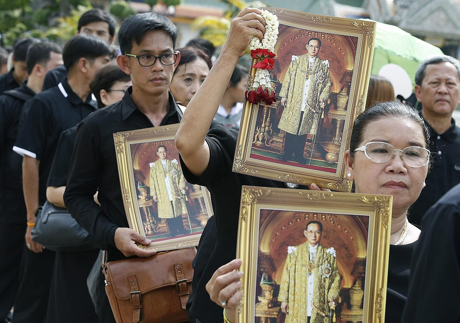 Thai mourners lining up to pay obeisance to the Royal Urn of the late King Bhumipol in Bangkok on Oct 29.