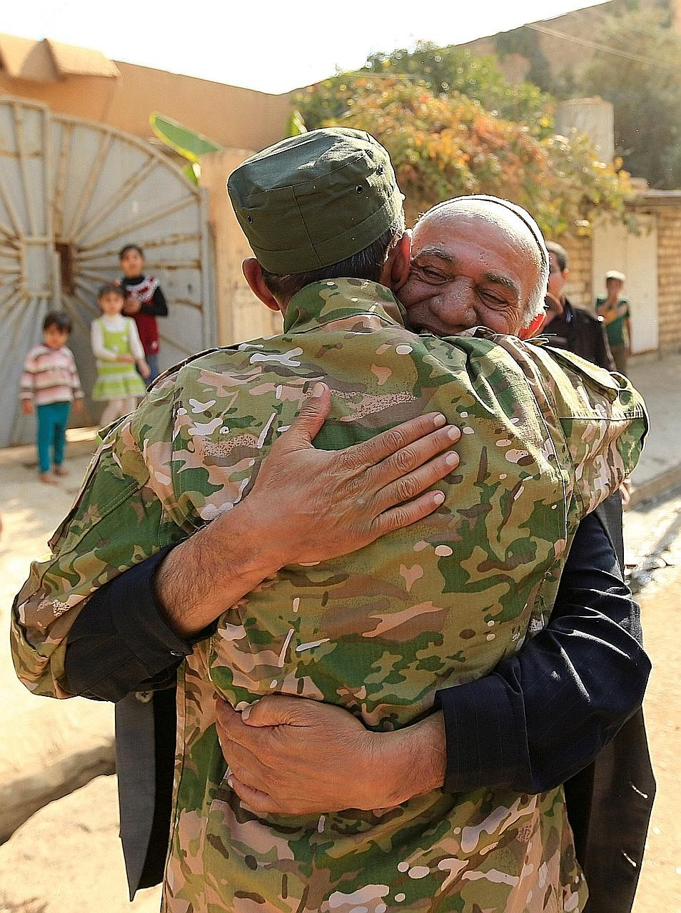 A displaced man welcoming a member of the Iraqi security forces on Sunday in the town of Hammam al-Alil, south of ISIS' Mosul stronghold.