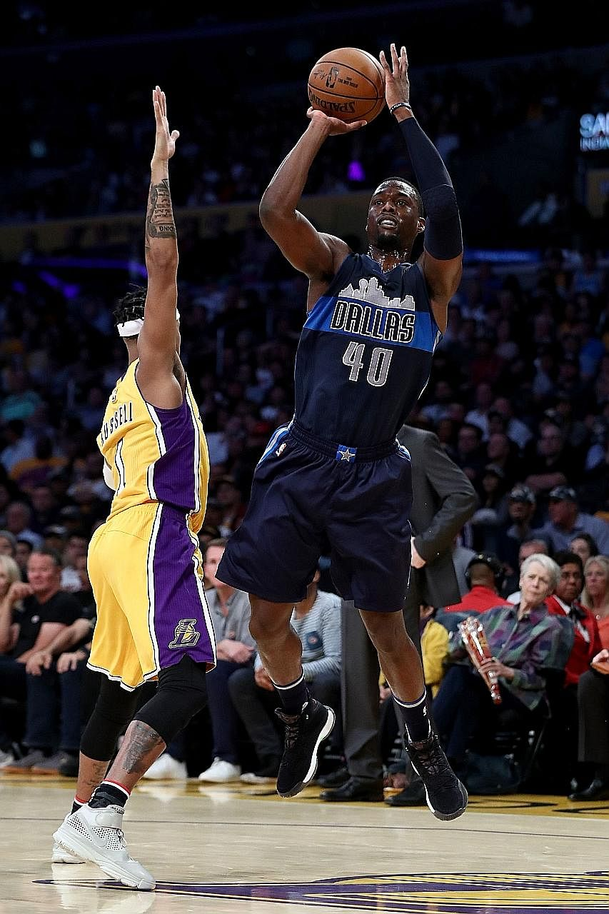 The Mavs' Harrison Barnes shooting over the Lakers' D'Angelo Russell in Dallas' 109-97 win. The forward scored 31 points.