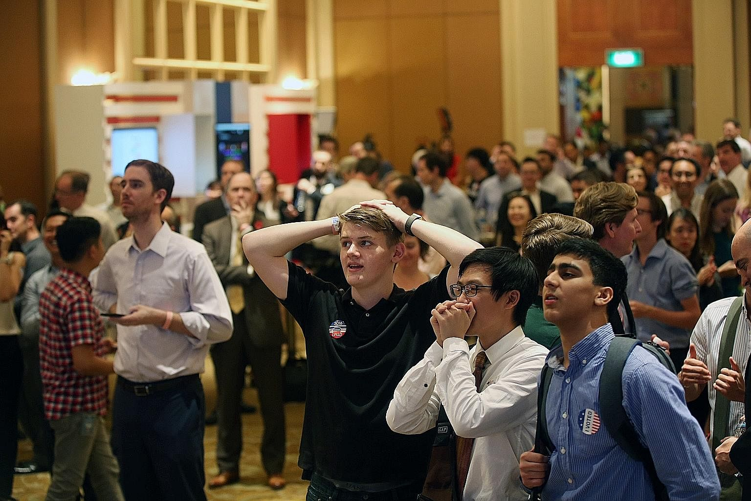 Guests at the US election results watch party yesterday reacting to live updates of the polls showing Mr Trump was pulling ahead and likely to win. US Ambassador to Singapore Kirk Wagar said at the start of the party that America will remain committe