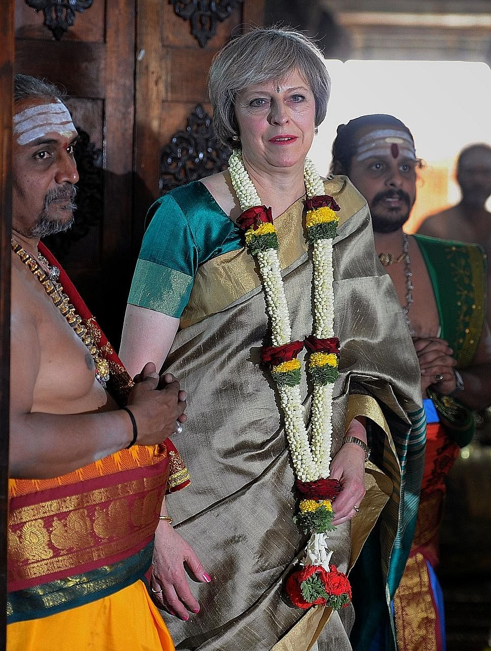 Mrs May visiting Someshwara Temple in Bengaluru on Tuesday. She is in India to ready the ground for post-Brexit trade deals. While pledging to make it easier to do business with the country, she is unwilling to ease visa restrictions, a key demand fr