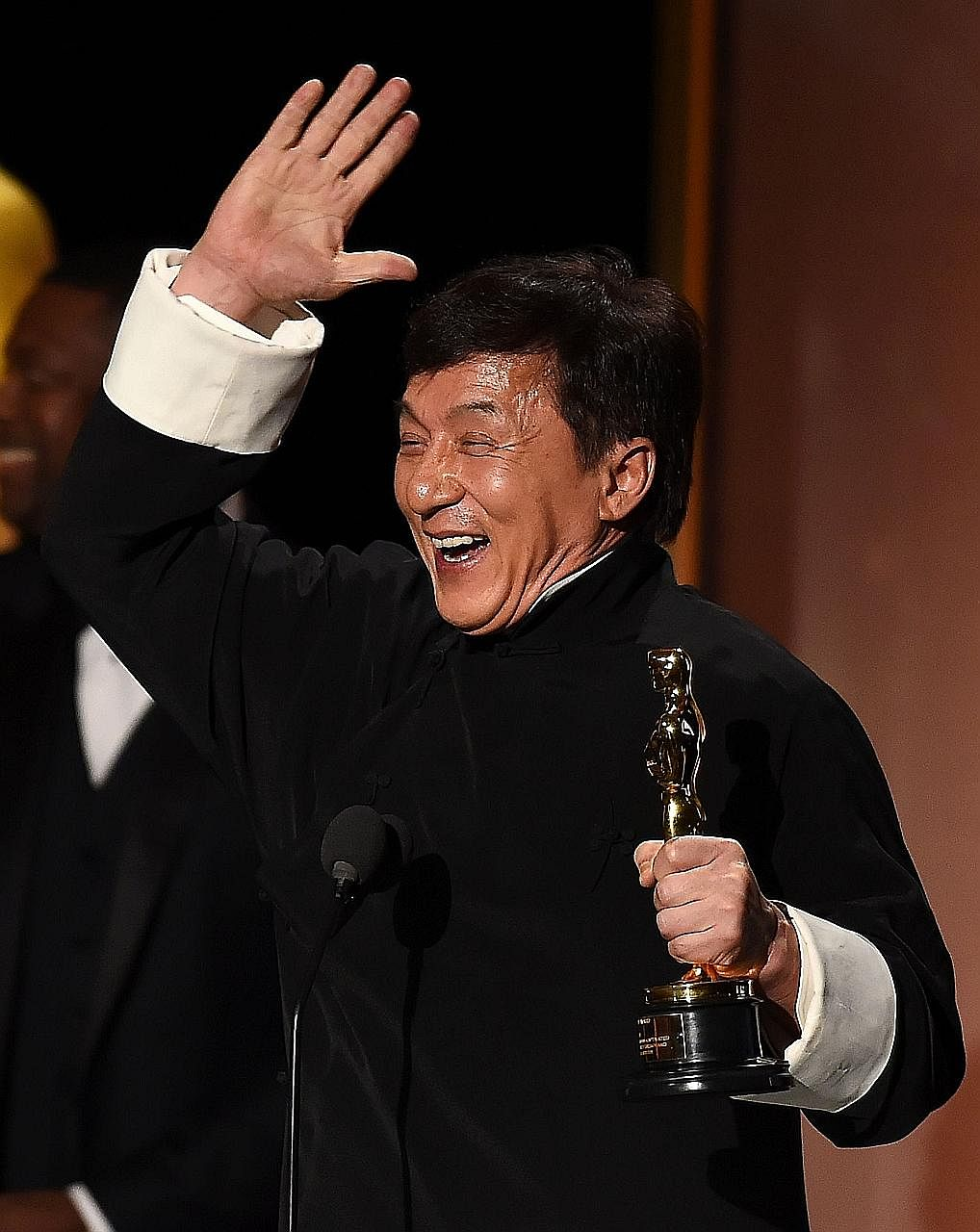 A jubilant Jackie Chan with his Honorary Oscar Award at the Academy's eighth Annual Governors Awards.