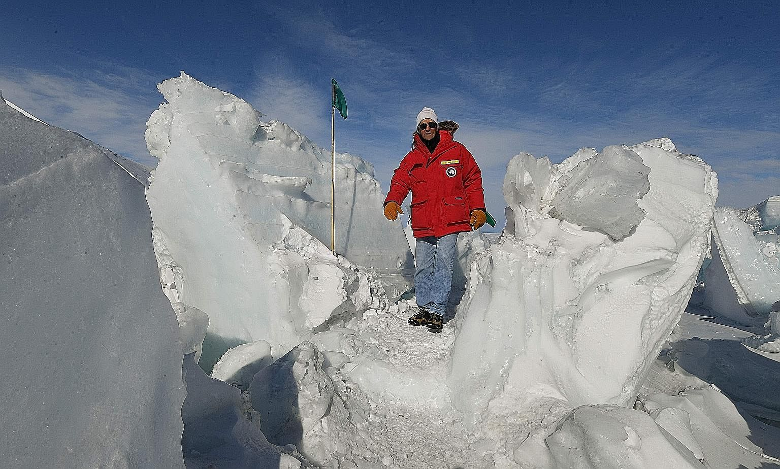 """Mr Kerry on a frozen section of the Ross Sea near Antarctica's McMurdo Station on Saturday. On climate change, he said """"we will wait to see how the next administration addresses this"""". Mr Trump at a rally in South Carolina in February. During campaig"""