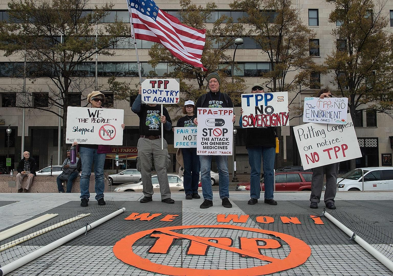 People demonstrating against the Trans-Pacific Partnership agreement in Washington, DC, on Monday. The Obama administration said last week that it would no longer try to get the trade deal through Congress, leaving the issue to President-elect Trump.