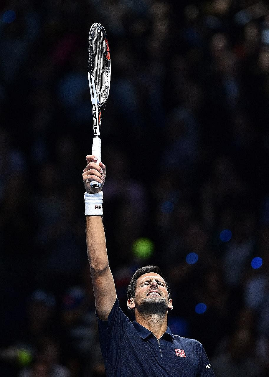 Novak Djokovic shows his relief after his 7-6 (8-6), 7-6 (7-5) win against Milos Raonic at the ATP World Tour Finals in London on Tuesday. The Serb dropped his serve twice in the second set but held on to win.