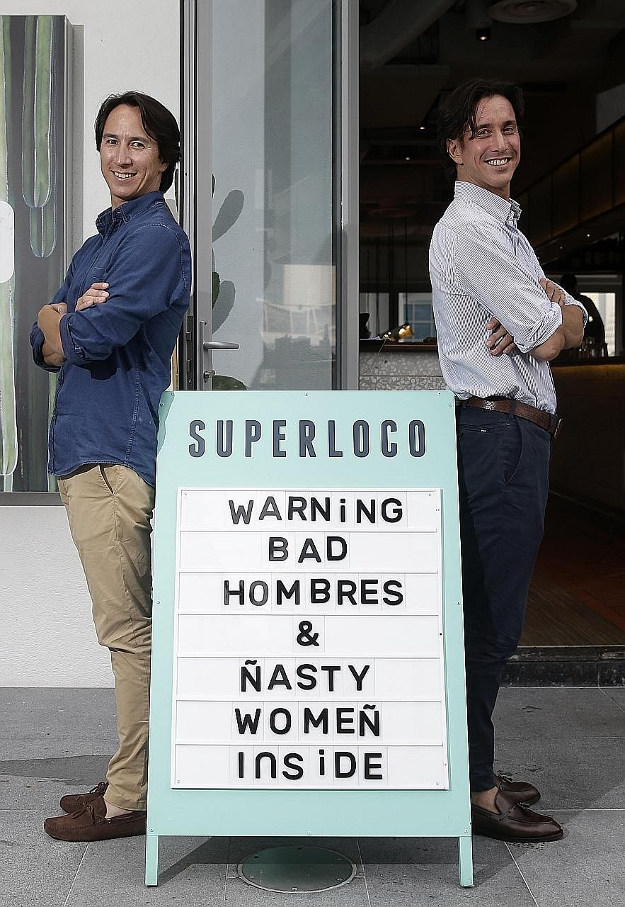 Julian (far left) and Christian Tan at their fun-loving two-month-old Mexican bar and restaurant Super Loco at Customs House.