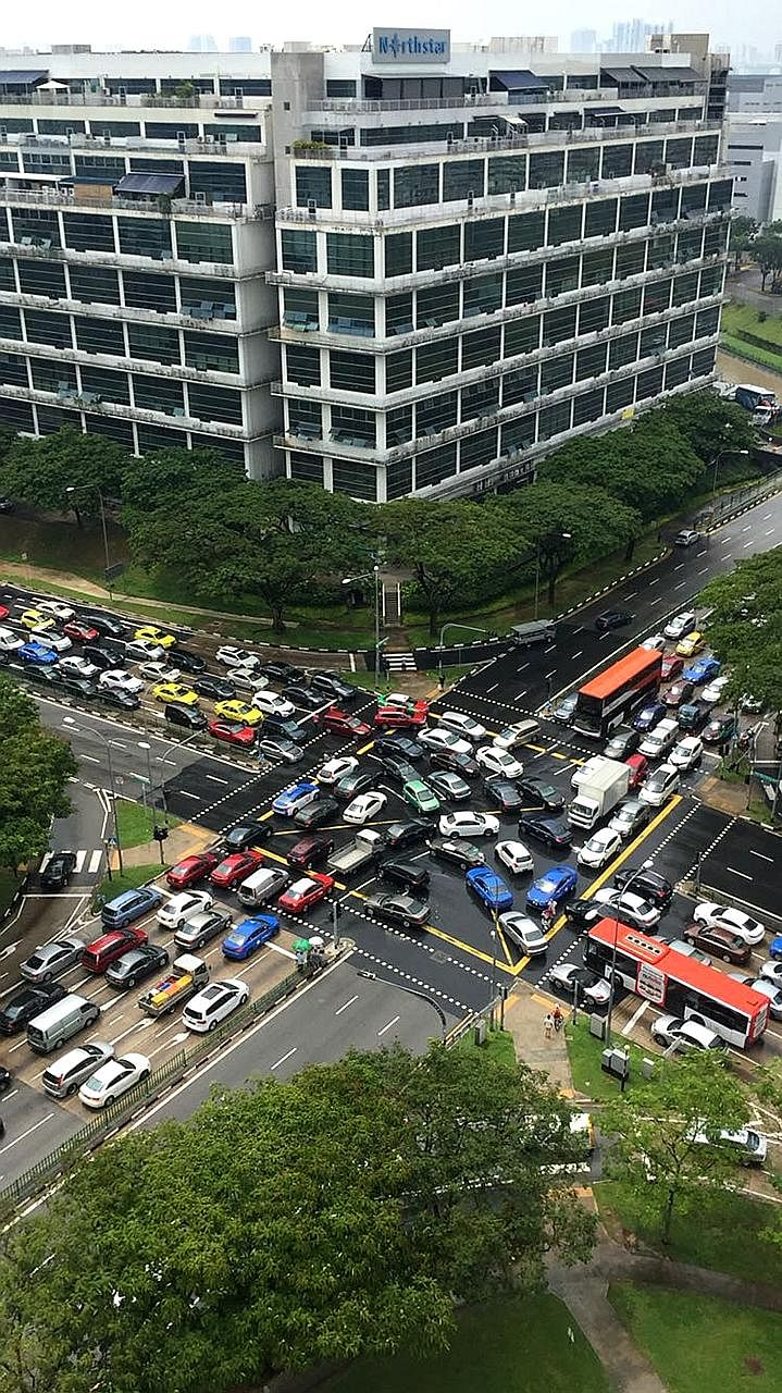 """The traffic lights at the junction of Yio Chu Kang Road and Ang Mo Kio Avenue 5 stopped working yesterday, causing a traffic jam. The Straits Times understands that a """"technical issue"""" had occurred with the traffic lights."""