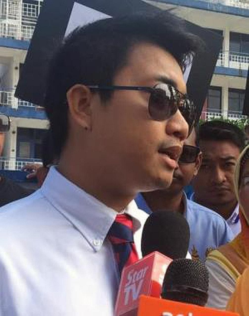 Malaysian PKR Youth chief Adam Rosly (above) owns a bungalow, worth S$2.26 million according to his detractors. The house (right), with its three conical roofs, stands out among the humbler structures in the Malay urban kampung enclave of Ampang.