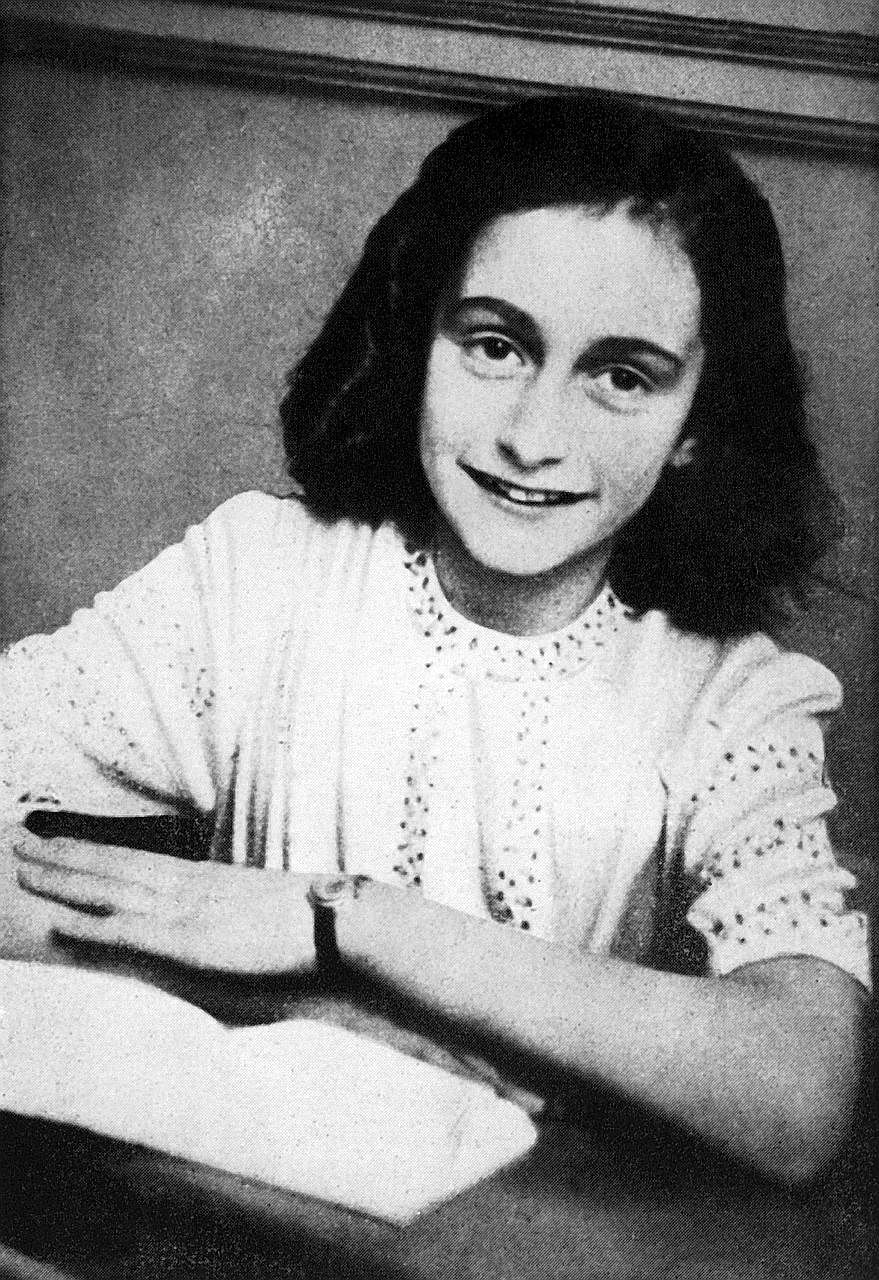 """The poem (left) was written by Anne Frank (above) shortly before she went into hiding from the Nazis. It was addressed to """"Cri-cri"""" or Christiane van Maarsen, signed by the Jewish teenager and dated March 28, 1942."""