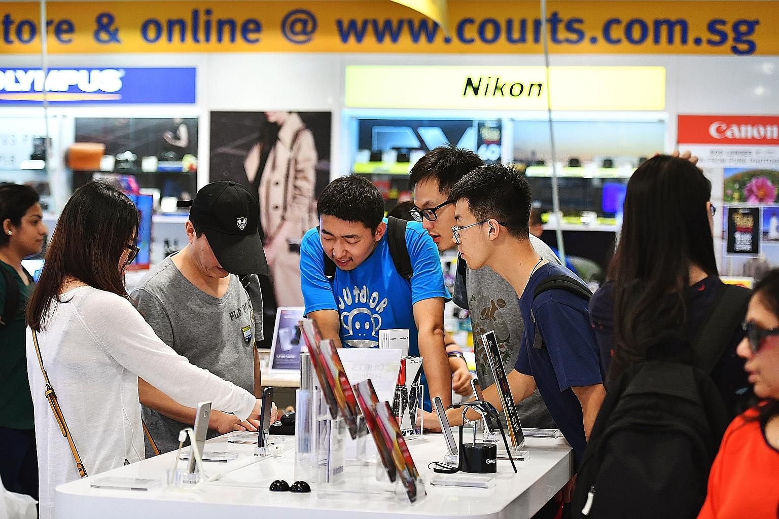 Courts' Black Friday sale covered all 14 outlets, including Courts Orchard (above), as well as its online store. The furniture chain also introduced a priority pass this year that let 280 pre-registered shoppers skip the queue. Shoppers at the Robins