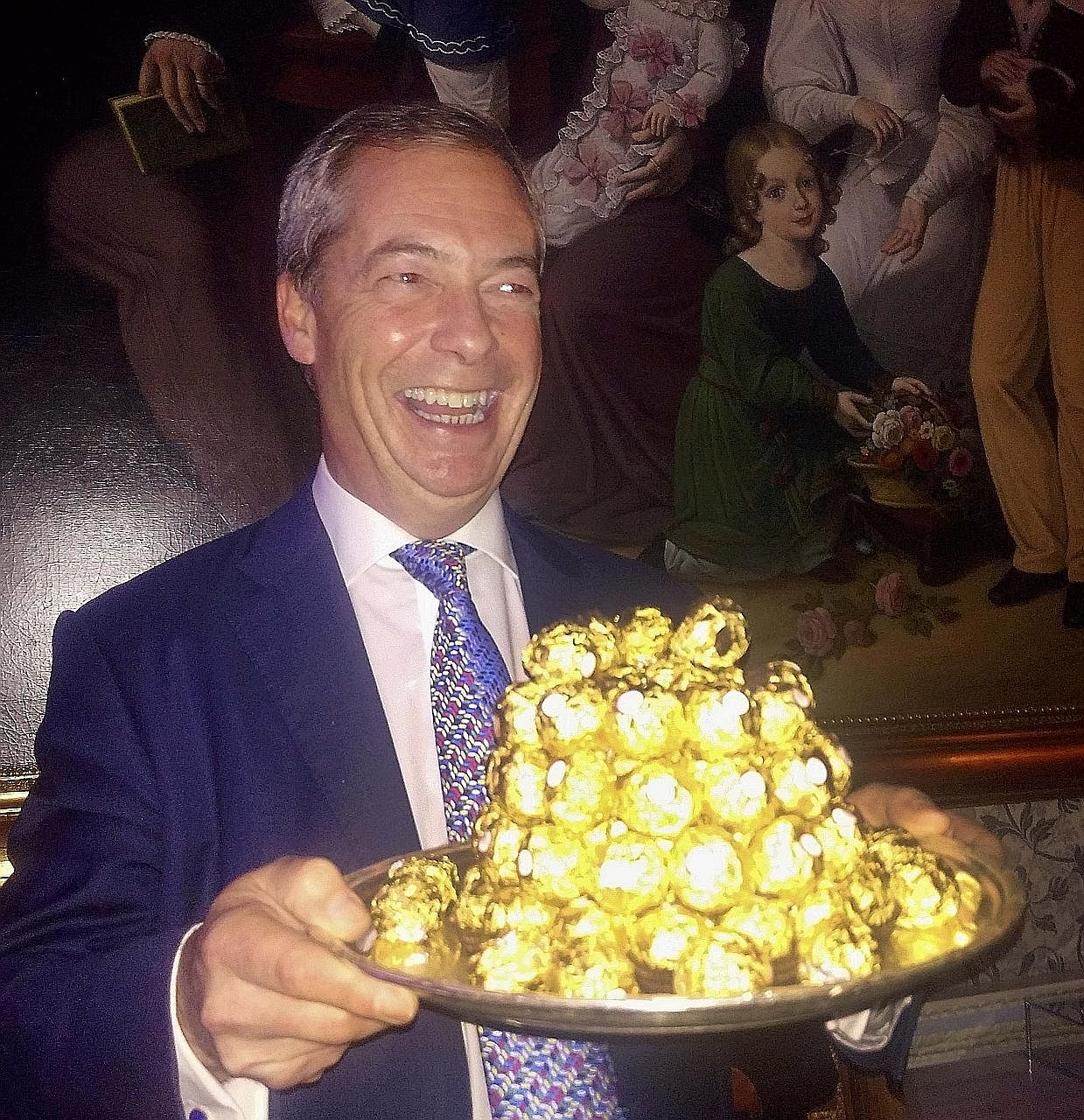 """Mr Farage, who has been backed by Mr Donald Trump to be Britain's next US ambassador, in a spoof of the 1990s Ferrero Rocher ad - that was set at an """"ambassador's reception"""" and included the oft-quoted line """"You are really spoiling us"""" - during a par"""
