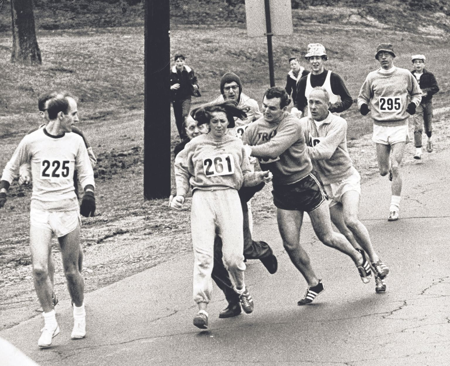 Kathrine Switzer (261) of Syracuse, New York, was spotted early in the 1967 Boston Marathon by race official Jock Semple (behind her in trousers), who tried to rip the number off her shirt and remove her from the race. The then 20-year-old's friends