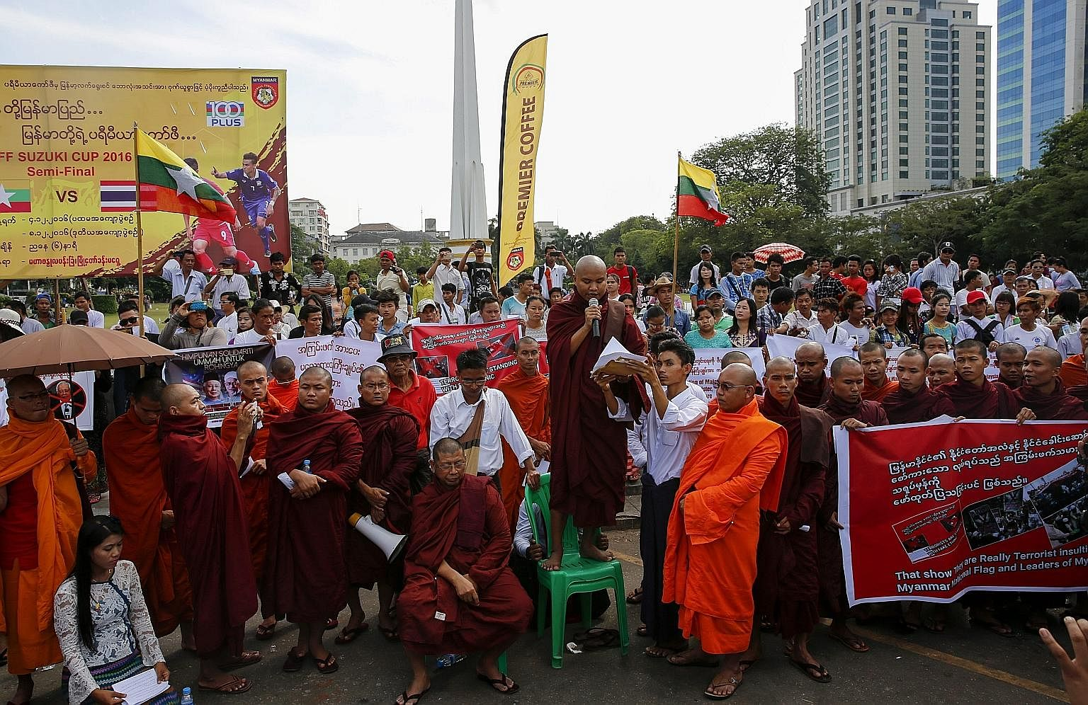 Myanmar Buddhist monks leading a protest in Yangon yesterday, condemning Mr Najib and demanding that he not pressure the Myanmar government over the Rohingya issue. PM Najib flanked by (from far left) PAS deputy president Tuan Ibrahim Tuan Man, Deput