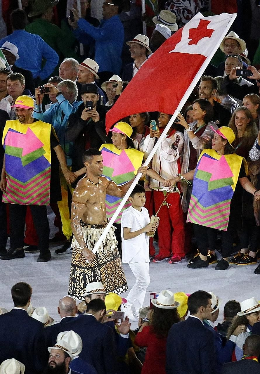 Tonga's flag-bearer Pita Taufatofua, who stole the limelight at the Rio Olympics opening ceremony, plans to compete at the 2018 Winter Olympics as a cross-country skier. Above: Taufatofua straps on skis at Bear Mountain, California, during the